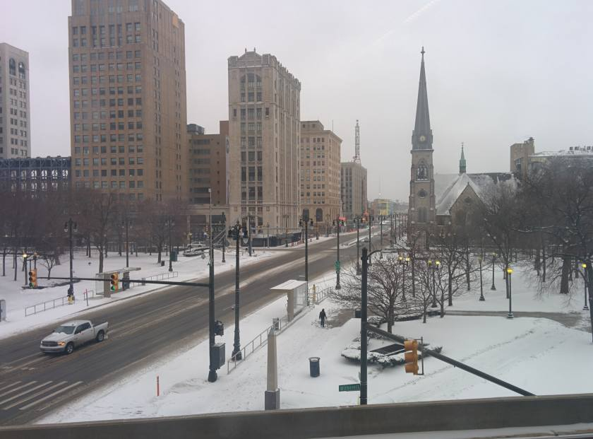 snowy view of Woodward and Grand Circus Park, Central United Methodist Church in the background